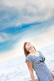 Happy girl in striped vest Stock Photo