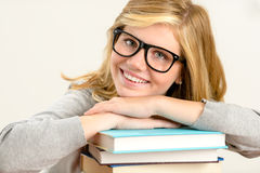 Happy girl student with stack of books Stock Images