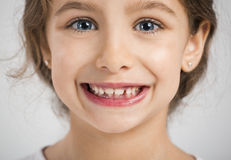 Happy girl. Studio portrait of a beautiful and happy girl smiling Stock Images