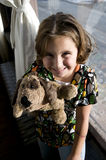 Happy girl with stuffed dog Stock Images