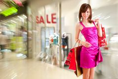 Happy girl after successful shopping Royalty Free Stock Image