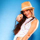 Happy girl in summer clothes and straw hat. Stock Photos