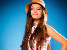 Happy girl in summer clothes and straw hat. Stock Photo
