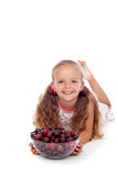 Happy girl with summer fruits - cherries in a bowl Royalty Free Stock Image
