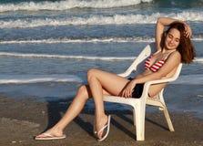 Happy girl summer sky swimsuit. Beautiful happy girl summer sky siiting in USA swimsuit royalty free stock photos