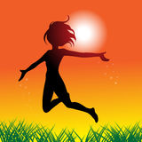 Happy girl in the sun. A girl jumping and running around with joy Royalty Free Stock Image