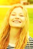 Happy girl in the sun. Happy blond girl in the sun Stock Photo