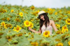 Happy girl between sunflower Royalty Free Stock Photography