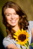 Happy girl with a sunflower Stock Photos