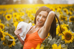 Happy girl in a sunflower's field Royalty Free Stock Image