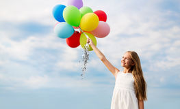 Happy girl in sunglasses with air balloons Stock Photos