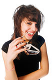 Happy girl with sunglasses in her mouth Stock Photography