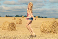 Happy girl in sunny autumn field Royalty Free Stock Photography