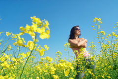 Happy girl on sunny flower field royalty free stock images