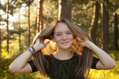 Happy girl in the sunny forest. Nature. Walk. Stock Photos