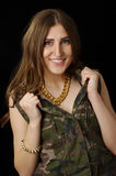 Happy girl with super big golden chain in army jacket Royalty Free Stock Photography
