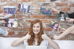 Happy girl surrounded by pictures Stock Photos