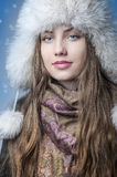 Happy Girl surrounded by snow. Royalty Free Stock Photo