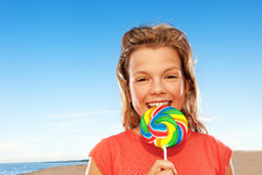 Happy girl with sweet candy Royalty Free Stock Images