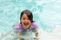 Happy girl swimming stock photos