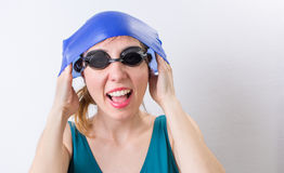 Happy girl with a swimming hat Royalty Free Stock Photos