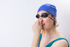 Happy girl with a swimming hat Royalty Free Stock Images