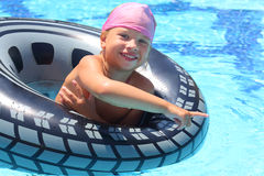 Happy girl swimming at the inflatable circle Stock Images