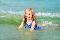 Happy girl swimming Stock Images