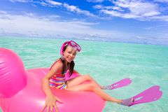 Happy girl swimming in ocean Stock Photo