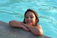 Happy girl in swimming pool. Portrait of happy young girl in swimming pool Royalty Free Stock Photos