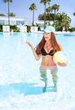 Happy girl in swimming pool Royalty Free Stock Image