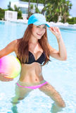 Happy girl in swimming pool Stock Photography