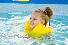 Happy girl swimming in the pool Royalty Free Stock Photo