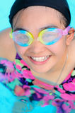 Happy girl in swimming pool Royalty Free Stock Images