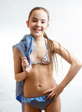 Happy girl in swimsuit posing with blue beach towel Royalty Free Stock Photos