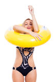 Happy girl in swimsuit with rubber ring Royalty Free Stock Photo