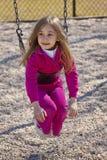 Happy girl on swing. Portrait of happy young preschool girl on swing outdoors stock photography