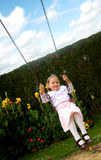 Happy girl on a swing Stock Photos