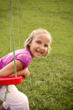 Happy girl on swing Stock Photo