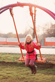 Happy girl on swing Royalty Free Stock Images