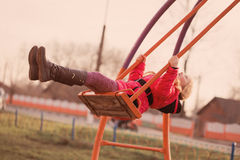 Happy girl on swing Stock Images