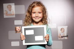 Happy girl with tablet computer Stock Images