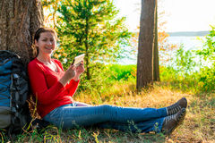 Happy girl with the tablet resting Royalty Free Stock Photos