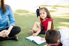 Happy girl taking a class outdoors stock photography
