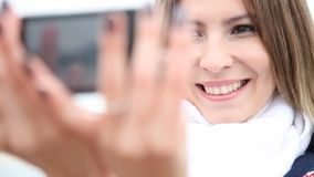 Happy girl taking photo of herself selfie Full HD with motorized slider. 1080p. Happy girl young woman taking photo of herself selfie with cell phone smartphone stock footage
