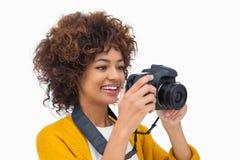 Happy girl taking a photo Stock Photo