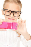 Happy girl taking picture with cell phone Royalty Free Stock Photos