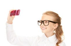 Happy girl taking picture with cell phone Stock Image