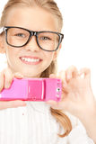 Happy girl taking picture with cell phone Stock Images
