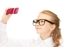 Happy girl taking picture with cell phone Royalty Free Stock Photography